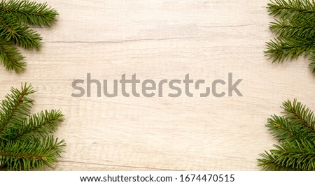 spruce twigs on wooden background frame #1674470515