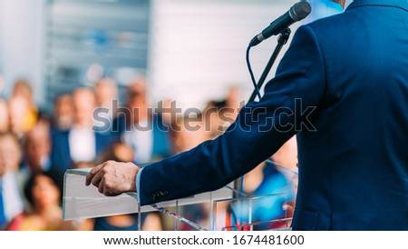Politician during election campaign, speaking to the crowd from stage #1674481600