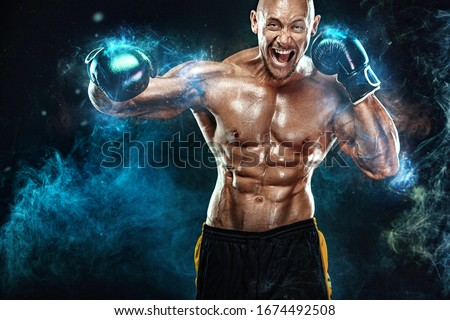 Sportsman, man boxer fighting in gloves on black background. Fitness and boxing concept. Action shoot. Individual sports recreation. #1674492508