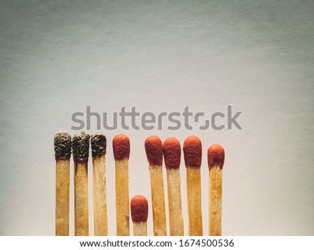 Matchsticks burn, one piece prevents the fire from spreading - the concept of how to stop the coronavirus from spreading: isolation, stay at home and social distance. Flat lay. Close up. #1674500536