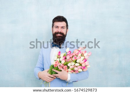 Valentines Day is finally here. Bearded man hold valentines flowers. Happy hipster with tulip bouquet. Valentines day celebration. Florists deliver on Valentines. Womens day. March 8. Spring. #1674529873