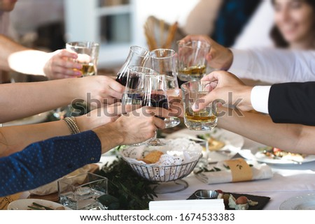 Celebration, eating and holidays concept - hands clinking wine glasses #1674533383
