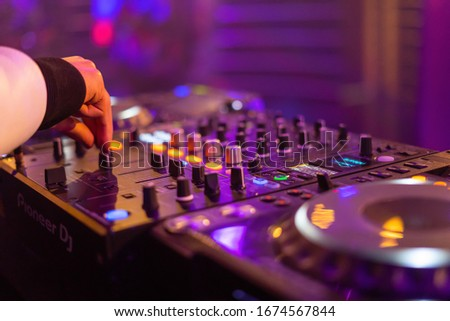 DJ Player while beeing used Royalty-Free Stock Photo #1674567844