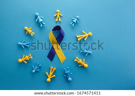 World Down syndrome day on blue background. Down syndrome awareness concept. Top view Royalty-Free Stock Photo #1674571411