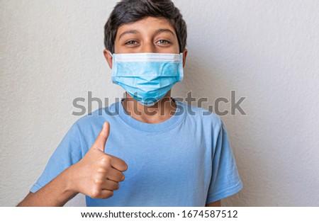 boy in blue shirt preventing corona virus #1674587512