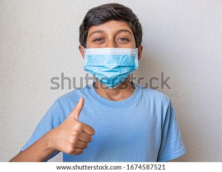 boy in blue shirt preventing corona virus #1674587521