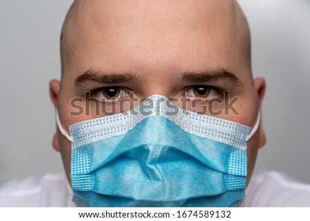 Man Wearing A Surgical Mask #1674589132