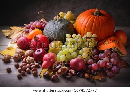 Pumpkins and autumn fruits in vintage setting, still life. Royalty-Free Stock Photo #1674592777
