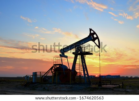 The war on oil prices caused by the coronavirus. Oil prices fall due to global crisis. Oil drilling derricks at desert oilfield. Crude oil production from the ground. Petroleum production, natural gas #1674620563