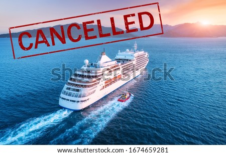 Cruise ship travel holidays cancelled because of epidemic of coronavirus. Crisis in the cruise industry. Cruise cancellation because of pandemic of Covid-19. Quarantine in cruise liner. Red text #1674659281