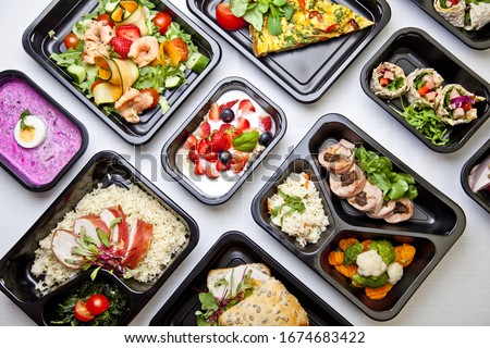 Catering food with healthy balanced diet delicious lunch box boxed take away deliver packed ready  meal in black container dinner, meal, brakfast #1674683422