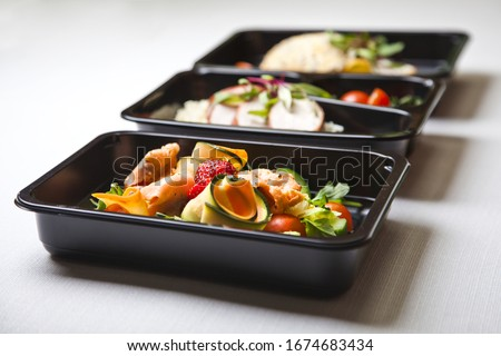 Catering food with healthy balanced diet delicious lunch box gastronomy boxed take away deliver packed ready meal in black container restaurant inn dinner, meal, brakfast #1674683434