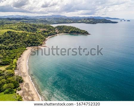 Aerial shot of the tropical beach Playa Arenillas in Costa Rica in peninsula Papagayo coast in guanacaste Royalty-Free Stock Photo #1674752320