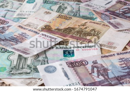 Paper banknotes Russian Rubles. Rubles is the national currency of Russia. bank of Russia The Russian ruble background. A thousand rubles close-up. Fall or rise of the ruble. #1674791047