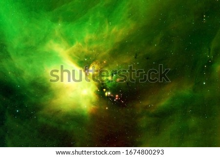 Beautiful space nebula of green color. Elements of this image were furnished by NASA. For any purpose.