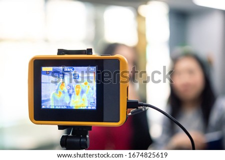 Asian people waiting for body temperature check before access to building for against epidemic flu covid19 or corona virus from wuhan in office by thermoscan or infrared thermal camera #1674825619