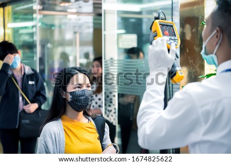 Asian people waiting for body temperature check before access to building for against epidemic flu covid19 or corona virus from wuhan in office by thermoscan or infrared thermal camera #1674825622