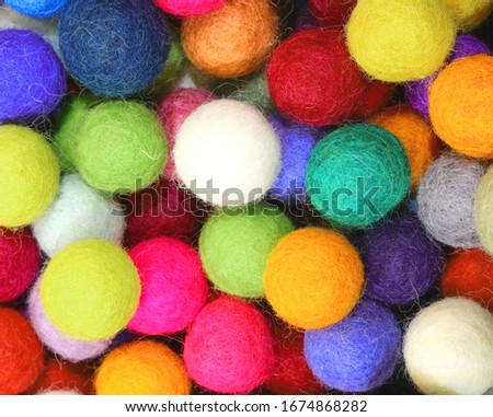 colorful balls made of felt for the decorations of the house on special occasions #1674868282