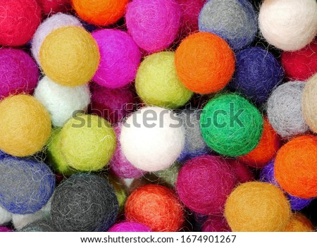 background of many colored balls made of felt that can be used to decorate the house #1674901267