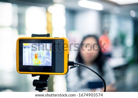 Asian people waiting for body temperature check before access to building for against epidemic flu covid19 or corona virus from wuhan in office by thermoscan or infrared thermal camera #1674903574