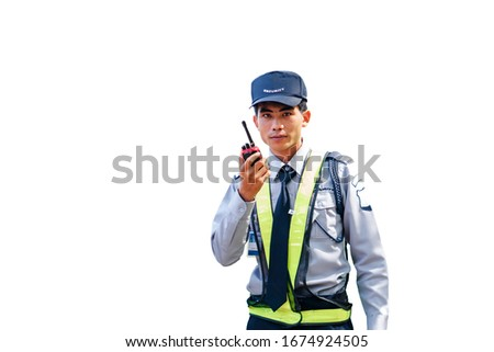 Asian security guard isolated on white background. Male security guard with portable radio transmitter. A security guard with portable radio transmitter.