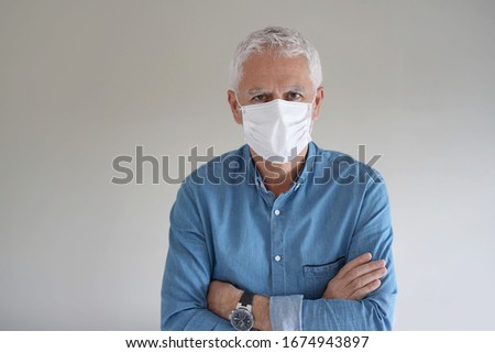 Man with protection mask on grey background - COVID19 #1674943897