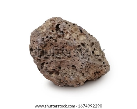 Basait stone isolated on white background. Basalt is a dark-colored, fine-grained, igneous rock composed mainly of plagioclase and pyroxene minerals. It most commonly forms as an extrusive rock, Royalty-Free Stock Photo #1674992290