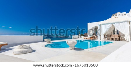 05.11.19 - Summer vacation panorama, luxury famous Europe destination. White architecture in Santorini, Greece. Perfect travel scenery with swimming pool and sea view. Wonderful blue sky and sunlight #1675013500