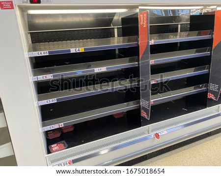 OXFORD, UK - March 16th 2020: Empty supermarket shelves at a local grocery store as people prepare for coronavirus lockdown #1675018654