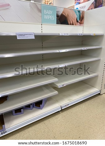 OXFORD, UK - March 16th 2020: Empty supermarket shelves at a local grocery store as people prepare for coronavirus lockdown #1675018690
