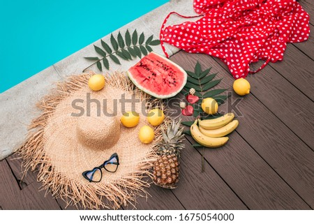 Summer mood. poolside relaxation. Chill near the pool. Fruits by the pool. Watermelon. Lemon, bananas. Fashion summer pic.