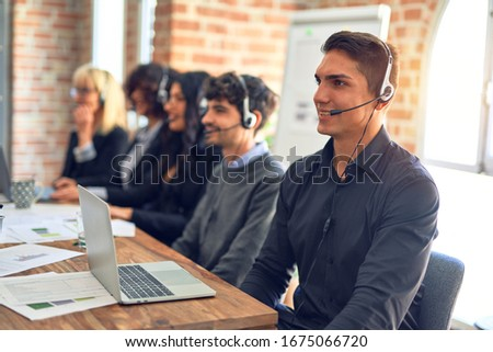 Group of call center workers smiling happy and confident. Working together with smile on face using headset at the office. #1675066720