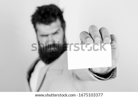 barbershop concept. best barber master. barber shop for gentlemen. brutal beauty. serious bearded man business card. copy space. confident mature businessman. blank piece of paper. selective focus.