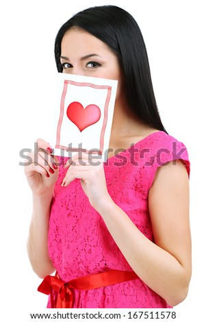 Attractive young woman with Valentine card isolated on white #167511578