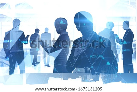 Silhouettes of diverse business people working together in blurry office with double exposure of cityscape and network hologram. Concept of internet connection and teamwork. Toned image #1675131205