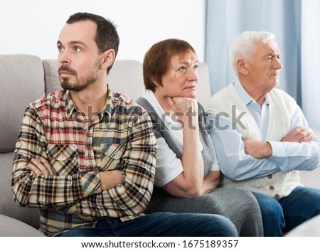 Old grandparents talking seriously with grandson and solve family problems #1675189357
