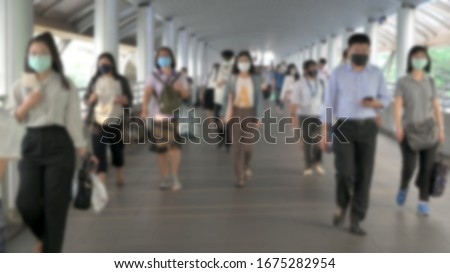 Blured defocused. The crowd is wearing protective masks prevent Coronavirus, Covid 19 virus during virus outbreak and PM2.5 air pollution crisis rush hour Bangkok, Thailand. #1675282954