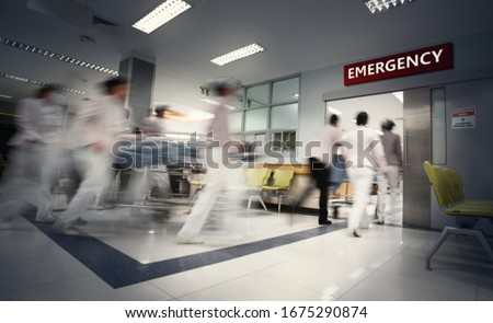 Blurry movement of nurses and doctors working in the hospital / soft focus and long speed shutter technique.New corona virus (novel Coronavirus 2019 disease,COVID-19,nCoV). Royalty-Free Stock Photo #1675290874