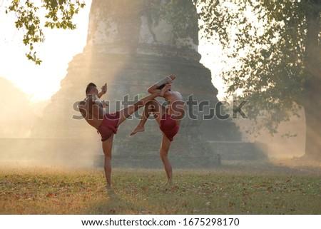 Martial arts of Muay Thai or Thai Boxing at Thailand, Muay Thai at Ayutthaya Thailand, Royalty-Free Stock Photo #1675298170
