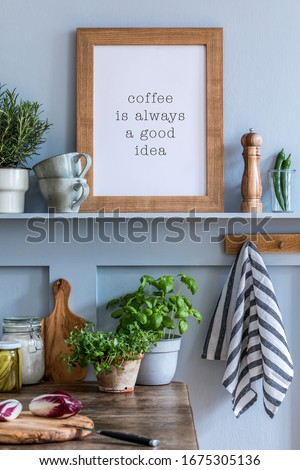 Interior design of kitchen space with mock up photo frame, wooden table, herbs, vegetables, food and kitchen accessories in modern home decor.
