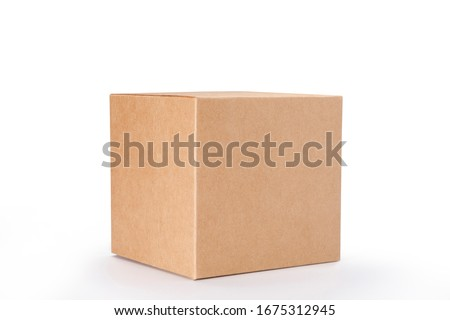 Brown cardboard box isolated on white background with clipping path. Suitable for food, cosmetic or medical packaging. Royalty-Free Stock Photo #1675312945