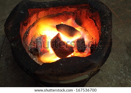 fire coals in the stove #167536700