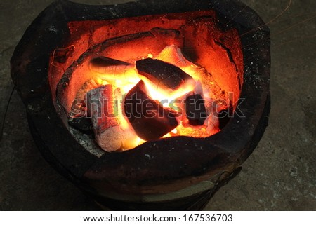 fire coals in the stove #167536703