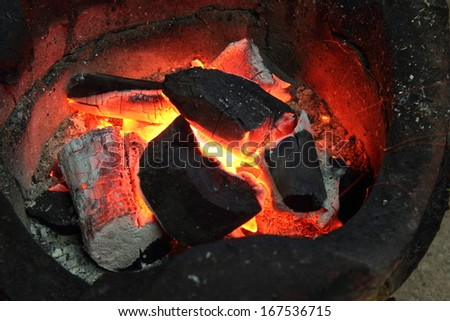 fire coals in the stove #167536715