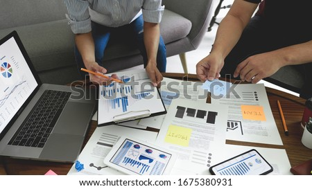 Business people meeting at office writing memos on sticky notes. planning strategy and brainstorming, colleagues thinking concept Royalty-Free Stock Photo #1675380931