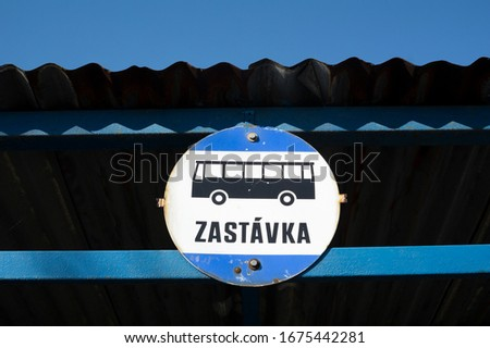 Bus stop in Czech Republic - sign showing place of arrivals and departures of buses, vehicles of public transport. Under pictogram is text Zastavka (translation from Czech: stop) #1675442281