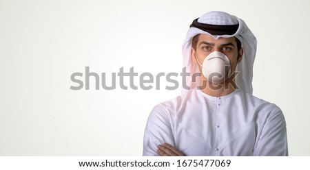 Arab man wearing medical face mask protecting himself from coronavirus, isolated on the background. #1675477069