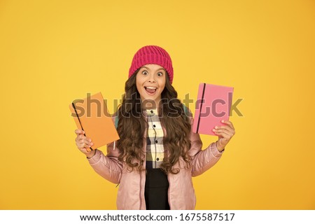 Little smiling girl hold books. Future textbooks modern education. Textbook useful in learning environment. School creating textbooks generation. Active role in curriculum. Schoolgirl with textbooks. #1675587517