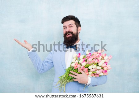 Flower bouquet for womens day. Bearded man with tulips. Flowers shop. Ideas to celebrate without breaking bank. Spring mood. Love date. Gift bouquet. Bearded man hipster with flower bouquet. #1675587631