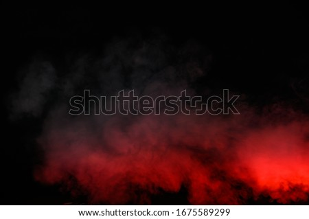 Red smoke isolated on black background